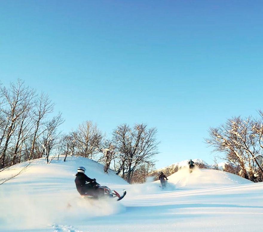 Exploring the back country of Myoko on snow mobiles